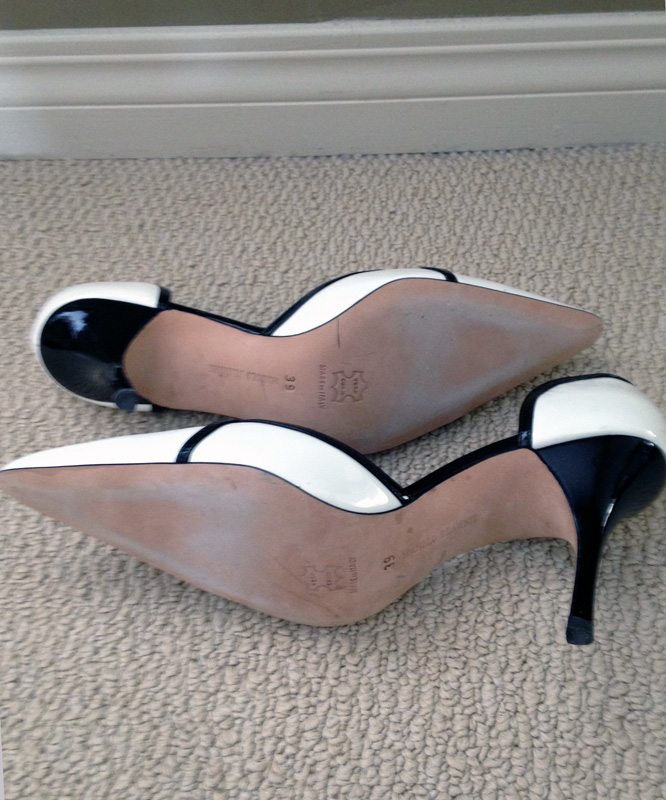 Manolo Blahnik white patennt pumps black trim