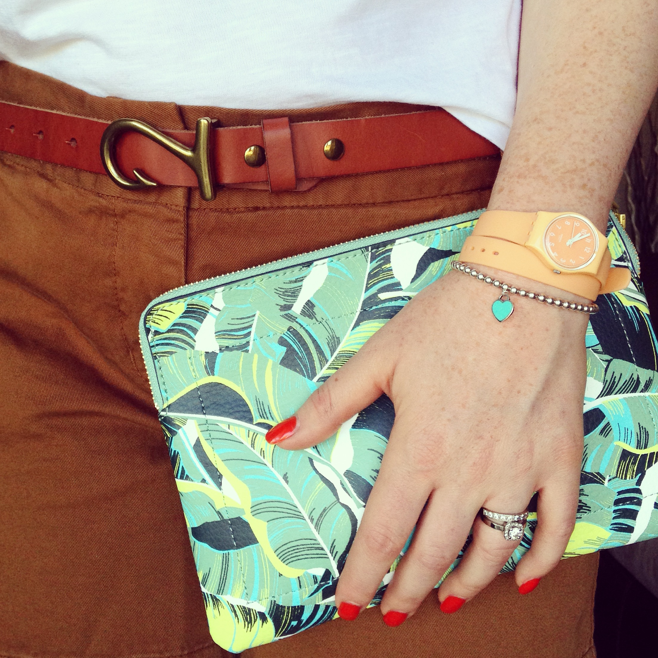 J. Crew brown chino shorts; Gap Palm leaf print clutch; Gap hook belt