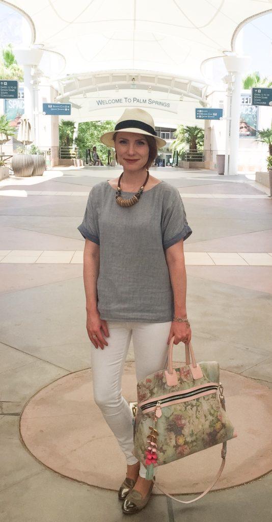 Top, Theory (via consignment); jeans, Frame (via consignment); shoes, AGL (via consignment); necklace, consignment; bag, consignment; hat, Aritzia