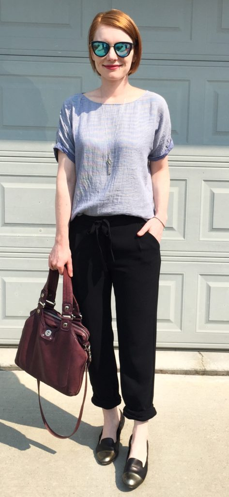 Top, Theory (via consignment); pants, Aritzia (via consignment); shoes, AGL (thrifted); necklace, Tiffany; bag, MbMJ